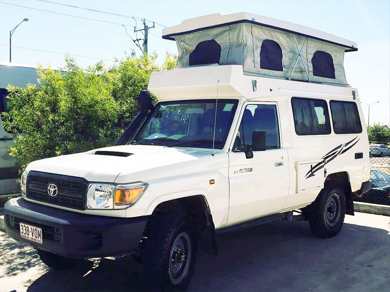 4WD Camper with pop top roof side view
