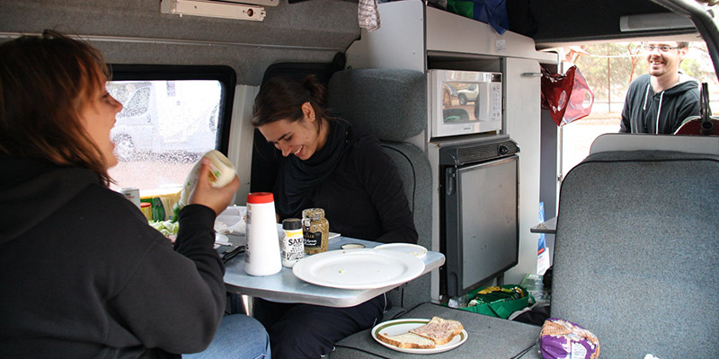 eating inside campervan